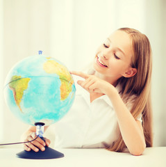 student girl with globe at school
