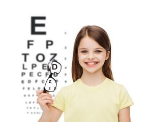 smiling cute little girl holding black eyeglasses