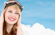 smiling teenage girl in snowboard goggles