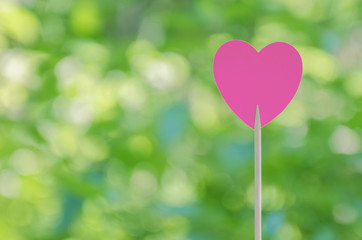 Pink heart with bokeh background