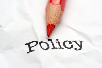 Pencil on policy text