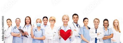 smiling doctors and nurses with red heart - 68853930
