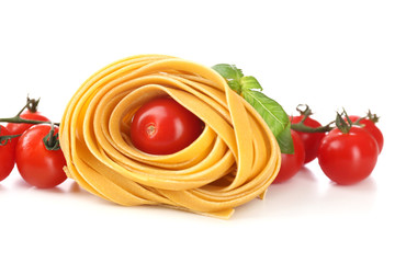 Raw homemade pasta and tomatoes, isolated on white