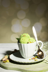 Tasty pistachio ice cream in cup