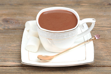Cup of hot chocolate on table, close up
