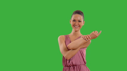 young beautiful girl in a dress on the green screen with alpha