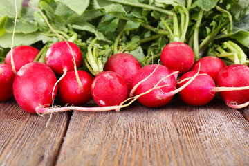 Heap of fresh radish on wooden background