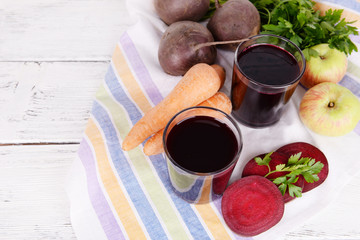 Glasses of fresh beet juice and vegetables
