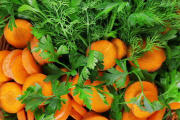 Slices of carrot and parsley closeup