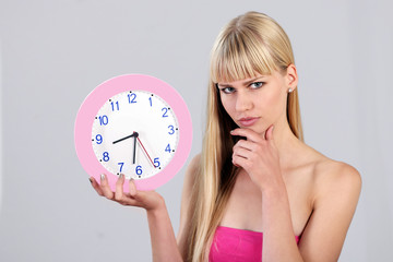 Cute girl shows the clock