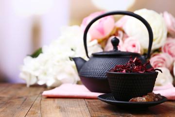 Black teapot, bowl and hibiscus tea
