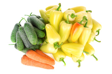 Yellow peppers with cucumbers and carrots isolated on white