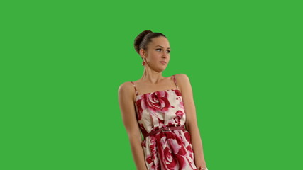 young beautiful woman with swatter  on a green screen .