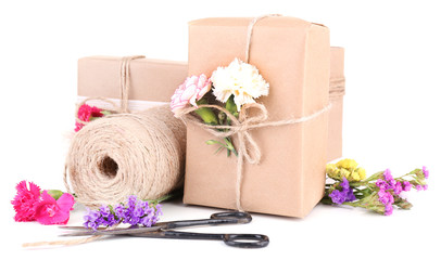 Beautiful gifts with flowers and decorative rope, isolated