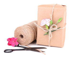 Beautiful gift with flowers and decorative rope, isolated