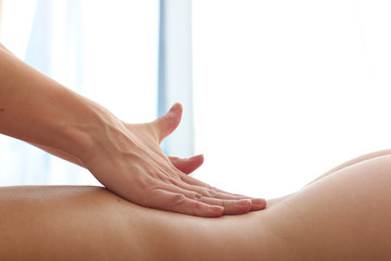 Nude back massage of a young lady