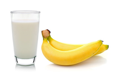 Glass of milk  with  banana over white background