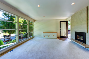 Empty house interior. Glass wall living room  with brick wall an