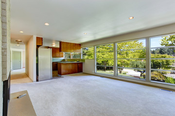 Empty house interior with open floor plan. Living room with kitc