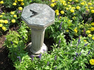 Traditional garden sundial: time by the shadow cast by the sun