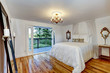 White bedroom interior with walkout deck