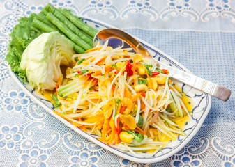 Local Thai papaya salad serve with vegetables