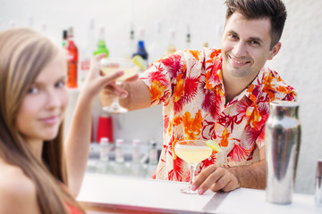 young girl and barmen with cocktail