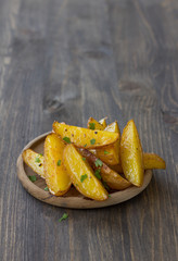 Baked new potatoes on wooden background