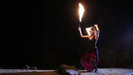 Artist turns the fiery fire-snakes fire performance