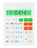 Calculator with DIVIDENDS on display isolated on white poster