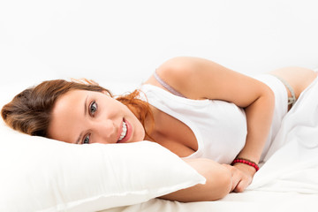 girl   awaking on white pillow