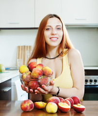 beautiful girl in yellow holding peaches