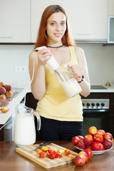 woman cooking dairy beverages with nectarines
