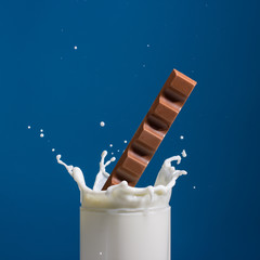 Splash of milk, caused by falling into a chocolate .