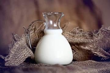 jug with milk burlap, village