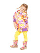 Girl in autumn clothes and rubber boots