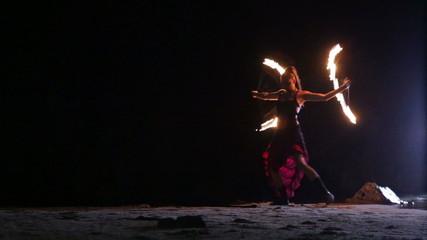 Artist turns the fire fans fire performance