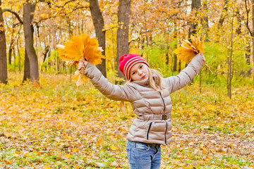 Cute dancing girl in autumn