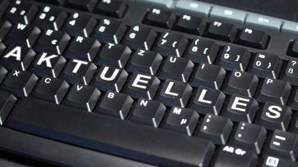 Computer Tastatur mit AKTUELLES Text - 16 zu 9 - g1078