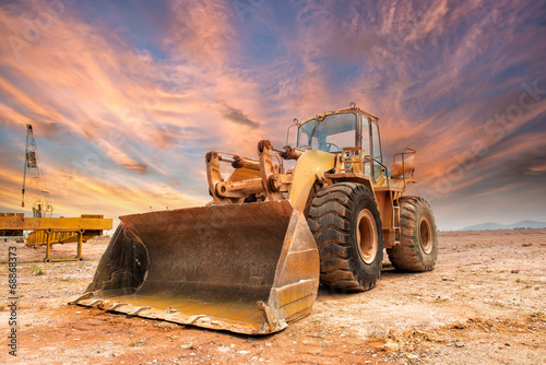 excavator loader machine during earthmoving works outdoors - 68868373
