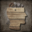 Open brain model made from wood, rusty metal gears and cogs - 68869959