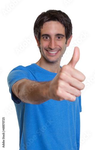 canvas print picture Mann mit schwarzen Haaren zeigt den Daumen