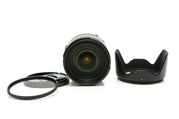 Camera lens ,lens cap and hood isolated on white background.