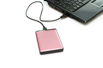 Pink external hard-disk on white