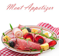 Meat appetizer on a plate on white background