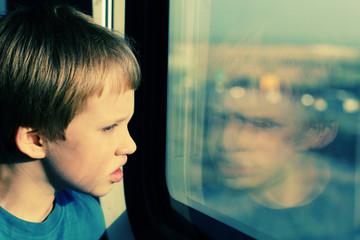 Boy looking through the window