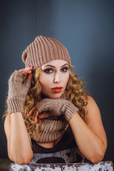 Portrait of a girl in a winter hat and mitten
