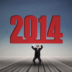 Businessman carrying a big number of 2014