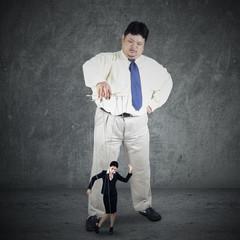 Businessman controlling his subordinate 2