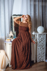 Girl in a brown maxi dress